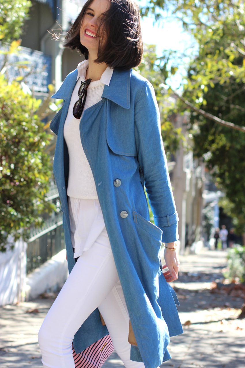 BYCHILL Chloe Hill wearing antipodium white jumper, Dress up blue trench coat and True Religion white jeans