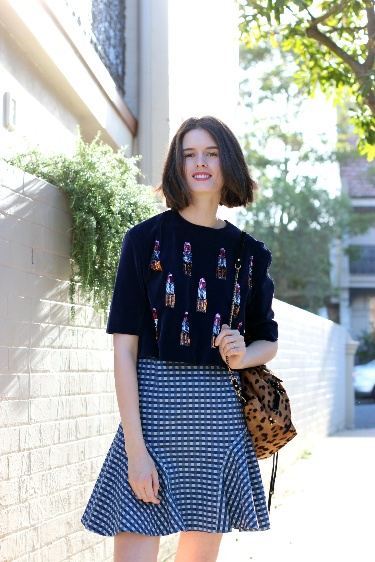 BYCHILL AUSTRALIAN FASHION BLOGS Chloe Hill Wearing House of Holland navy velvet top with sequin lipstick detail, Bianca Spender blue gingham check skirt and Jerome Dreyfuss leopard print ponyhair backpack